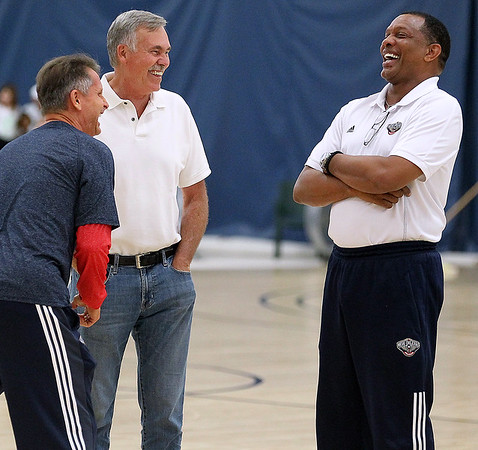 Brad Davis/The Register-Herald<br /> Mullens native and former NBA head coach Mike D'antoni, middle, shares some laughs with Pelicans head coach Alvin Gentry, right, and one of his assistants, left, during New Orleans Pelicans training camp Wednesday afternoon in White Sulphur Springs.