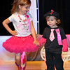 Brad Davis/The Register-Herald<br /> Kaylee Martin and David Martin walk the stage during the 7th annual Pretty in Pink Pageant Sunday afternoon in the Woodrow Wilson High School auditorium, a fundraising event for the Susan G. Komen Foundation and Newspapers in Education.