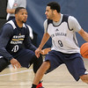 Brad Davis/The Register-Herald<br /> Guard Corey Webster, right, works along the perimeter as guard Eric Gordon defends during New Orleans Pelicans training camp Wednesday afternoon in White Sulphur Springs.