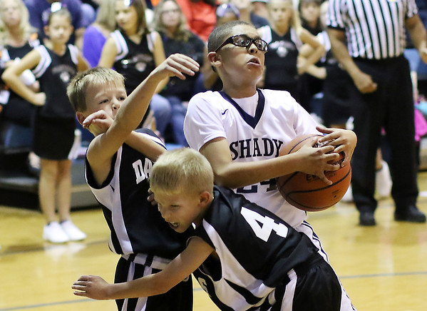 Chris Jackson/The Register-Herald<br /> Shady Spring's Cameron Mann (24) grabs a rebound over Daniels Jack Williams (13) and Jake Pate (4) during their basketball game Monday in Coal City.