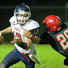 Chris Jackson/The Register-Herald<br /> Independence quarterback Ryan Brandstetter (12) shakes off a tackle from Liberty's Nevie Workman (20) during their football game Friday night in Glen Daniel.