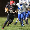 Brad Davis/The Register-Herald<br /> Liberty running back Christian Whittaker gains a chunk of yards during a soggy contest with Princeton Friday night in Glen Daniel.