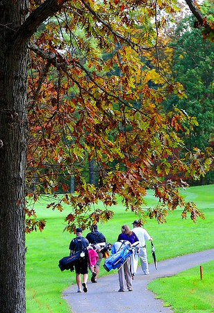 Rick Barbero/The Register-Herald<br /> Golfers and spectators walking on the 15th hole during the MEC Men's Golf Championship held on the Cobb Course at The Resort at Glad Springs Monday morning.