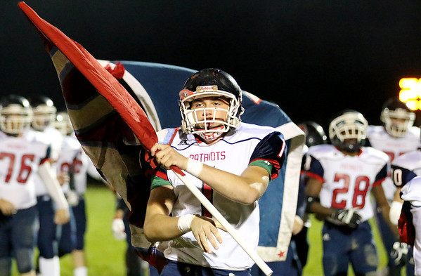 Chris Jackson/The Register-Herald<br /> Independence's Keeton Asbury (1) carries a flag onto the field prior to their football game against Liberty Friday night in Glen Daniel.