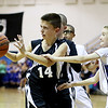 Chris Jackson/The Register-Herald<br /> Daniels Sam Jordan (14) grabs a rebound from Shady Spring's Colby Bragg during their basketball game Monday in Coal City.