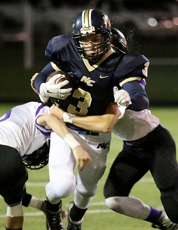 Chris Jackson/The Register-Herald<br /> Nicholas County's Carter Sebert-Sweeney (3) is tackled by two James Monroe defenders during the first half of their football game in Summersville  on Friday, Oct. 2.