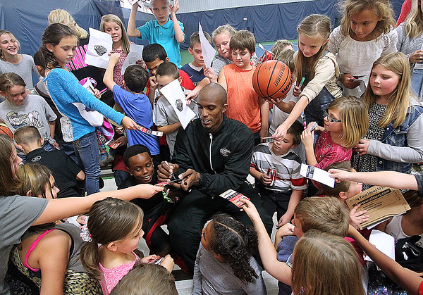Brad Davis/The Register-Herald<br /> New Orleans Pelicans player Dante Cunningham is engulfed in a swarm of school children seeking his autograph following day two of the team's training camp Wednesday afternoon in White Sulphur Springs.