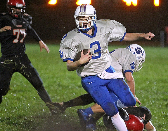 Brad Davis/The Register-Herald<br /> Princeton quarterback Christian Shafer carries the ball during the Tigers win over Liberty Friday night in Glen Daniel.