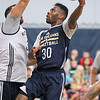 Brad Davis/The Register-Herald<br /> Guard Norris Cole, right, drives to the basket as forward Ryan Anderson defends during New Orleans Pelicans training camp Wednesday afternoon in White Sulphur Springs.