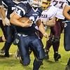 Brad Davis/The Register-Herald<br /> Meadow Bridge running back Shane Harless rumbles forward against Sherman Friday night.