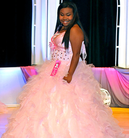 Brad Davis/The Register-Herald<br /> Daae-Von Bradford strikes a pose in the 13-15-year-old division during the 7th annual Pretty in Pink Pageant Sunday afternoon in the Woodrow Wilson High School auditorium, a fundraising event for the Susan G. Komen Foundation and Newspapers in Education.