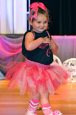 Brad Davis/The Register-Herald<br /> Three-year-old Gracelyn Hunter walks the stage during the 7th annual Pretty in Pink Pageant Sunday afternoon in the Woodrow Wilson High School auditorium, a fundraising event for the Susan G. Komen Foundation and Newspapers in Education.