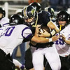 Chris Jackson/The Register-Herald<br /> Nicholas County quarterback Tate Mayes is brought down by several James Monroe defenders during the first half of their football game in Summersville  on Friday, Oct. 2.
