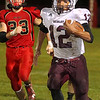 Brad Davis/The Register-Herald<br /> Woodrow Wilson running back Micah Hancock breaks loose and torches the Red Devils' defense for a long touchdown run Friday night in Oak Hill.