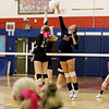 Chris Jackson/The Register-Herald<br /> Independence's Madison Testement (24) spikes a volley over Liberty's Taylor Daniel (23) during their match in Coal City.