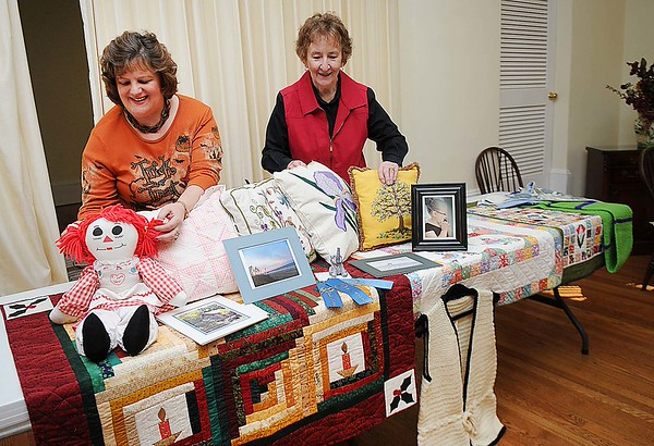 Rick Barbero/The Register-Herald<br /> Cindy Worley, acting president, left, and Betty J McClung, financial secretary, arrange some items on a table at the Beckley Woman's Club on Park Ave. in Beckley.