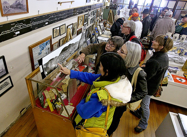 Brad Davis/The Register-Herald<br /> Visitors browse hundreds of historic photos and other relics of the railroad's boom days during Hinton's Historic Railroad Days Festival Sunday afternoon inside the town's railroad museum.