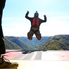 Chris Jackson/The Register-Herald<br /> A BASE jumper leaps off the exit point as others wait to go during the annual Bridge Day event in Fayetteville on Saturday.