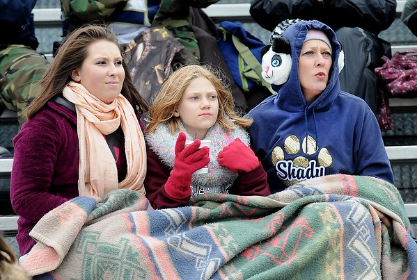 Rick Barbero/The Register-Herald<br /> Shady Spring fans wrapped up in a blanket during game against Oak Hill at Shady Spring High School.