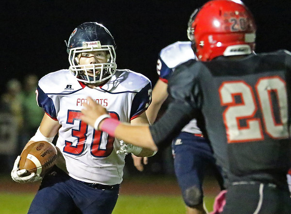 Chris Jackson/The Register-Herald<br /> Independence's Chris Mills (30) looks to run during their football game against Liberty Friday night in Glen Daniel.