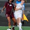 Brad Davis/The Register-Herald<br /> Woodrow Wilson's Emily Harrah passes the ball against GW Thursday evening at the YMCA Paul Cline Memorial Sports Complex.