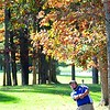 Rick Barbero/The Register-Herald<br /> Alex Lytle, of Glenville, chips on the 14th green during the MEC Men's Golf Championship held on the Cobb Course at The Resort at Glad Springs Monday morning.