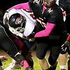 Chris Jackson/The Register-Herald<br /> Liberty's Cameron Dillon (70) brings down Independence's Chris Mills (3) during their football game Friday night in Glen Daniel.