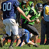 Brad Davis/The Register-Herald<br /> WV Storm running back Jacob Reynolds cuts back and changes direction prior to breaking loose for a long touchdown run during a charity football game between the Mt. Hope based adult team and a team of past high school players from around the area Sunday afternoon at Shady Spring High School.