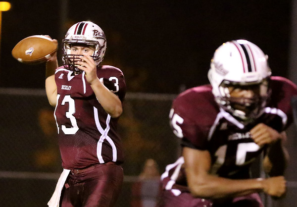 Chris Jackson/The Register-Herald<br /> Woodrow Wilson quarterback Sutton Radford (13) looks to pass during the third quarter of their football game against Riverside Friday in Beckley.