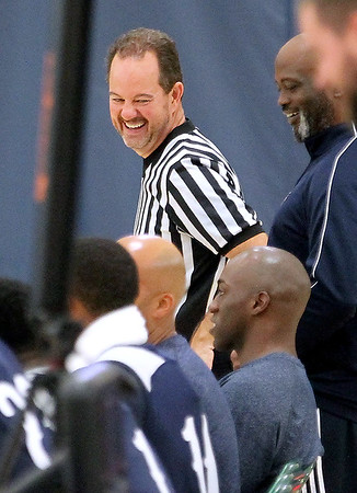 Brad Davis/The Register-Herald<br /> Area high school referee John Mills shoots the breeze with players and coaches during New Orleans Pelicans training camp Wednesday afternoon in White Sulphur Springs.