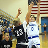 Rick Barbero/The Register-Herald<br /> Branden Chapman, right, of Cranberry Elementary, drives to the basket against,  Adam Richmond, of Shady Spring during the Championship game of the Raleigh County Elementary School basketball tournament held at Independence Middle School Tuesday evening.