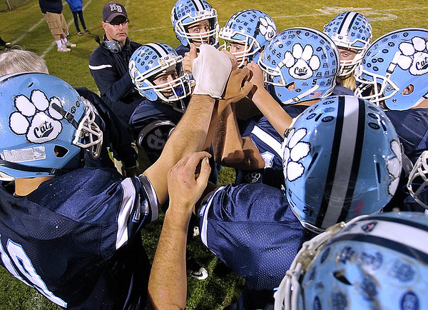 Brad Davis/The Register-Herald<br /> Meadow Bridge players get fired up prior to their game against Sherman Friday night in Fayette County.