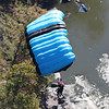 Chris Jackson/The Register-Herald<br /> A tandem BASE jumper descends into the New River Gorge during the annual Bridge Day event in Fayetteville.