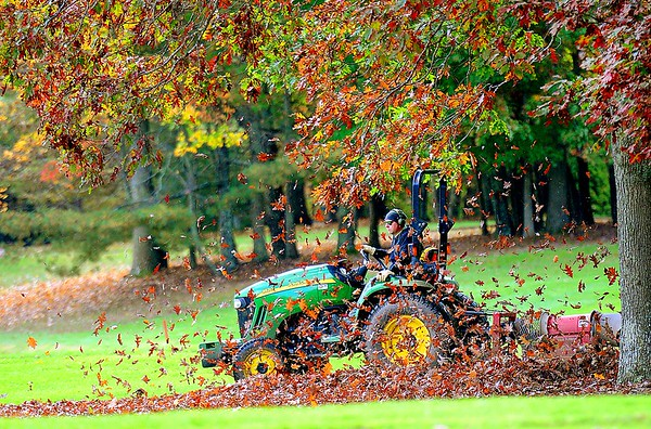Rick Barbero/The Register-Herald<br /> Adam Kaminski, blowing leaves during the MEC Men's Golf Championship held on the Cobb Course at The Resort at Glad Springs Monday morning.