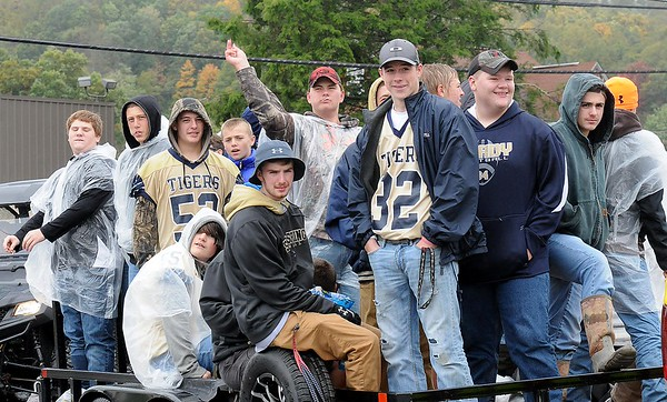 Rick Barbero/The Register-Herald<br /> Shady football players in the Shady Spring homecoming parade on Route 19 in Shady Spring Saturday morning.