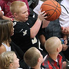 Brad Davis/The Register-Herald<br /> A lucky youngster is a Saints jersey catches a loose ball that got away during practice. Unfortunately, he had to throw it back.