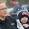 Rick Barbero/The Register-Herald<br /> Macalah Lefler, left, holds her brother Maverick Davis who was named Little Mr. Tiger during Shady Springs homecoming game against Oak Hill Saturday afternoon.