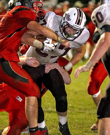 Brad Davis/The Register-Herald<br /> Woodrow Wilson running back Trey Cole carries the ball Friday night in Oak Hill.
