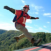 Chris Jackson/The Register-Herald<br /> A BASE jumper steps off the exit point backwards during the annual Bridge Day event in Fayetteville on Saturday.