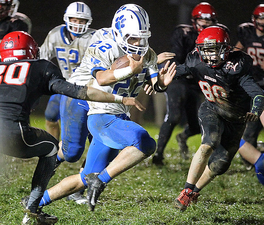 Brad Davis/The Register-Herald<br /> Princeton running back Phillip Jones cuts through the Raider defense during the Tigers win over Liberty Friday night in Glen Daniel.