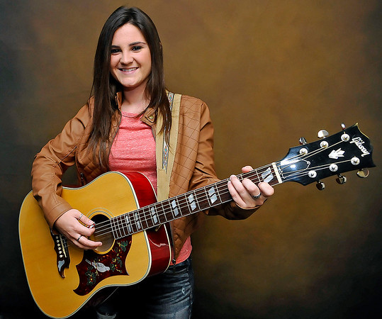 Brad Davis/The Register-Herald<br /> Local musician Krista Hughes poses for a quick photo during a visit to The Register-Herald offices Wednesday afternoon.