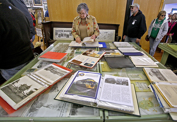 Brad Davis/The Register-Herald<br /> Forest Hill resident Judith Dolphin sifts through C&O employee records, among other historic items, inside Hinton's railroad museum during the town's Historic Railroad Days festival Sunday afternoon.