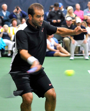 Brad Davis/The Register-Herald<br /> Pro Emeritus and tennis legend Pete Sampras competes against former pro James Blake at the Greenbrier Champions Tennis Classic Sunday afternoon in White Sulphur Springs.