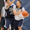 Brad Davis/The Register-Herald<br /> Forward Ryan Anderson, right, gets a pass away as forward/center Anthony Davis defends during New Orleans Pelicans training camp Wednesday afternoon in White Sulphur Springs.
