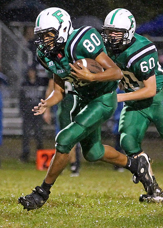 Brad Davis/The Register-Herald<br /> Fayetteville's Marcus Lively carries the ball against Man Friday night.
