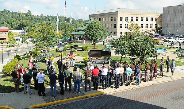 Rick Barbero/The Register-Herald<br /> Crowd gathers together during a 9/11 ceremony held at Word Park on Neville Street in Beckley Friday morning.