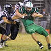 Brad Davis/The Register-Herald<br /> Fayetteville's Dalton Dempsey is wrapped up by Man defenders Friday night in Fayetteville.