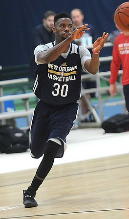 Rick Barbero/The Register-Herald<br /> Norris Cole receiving a pass during the New Orleans Pelicans training camp held at The Greenbrier Resort in White Sulphur Springs Tuesday afternoon.