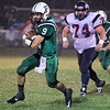 Brad Davis/The Register-Herald<br /> Fayetteville's Jordan Dempsey carries the ball against Man Friday night.