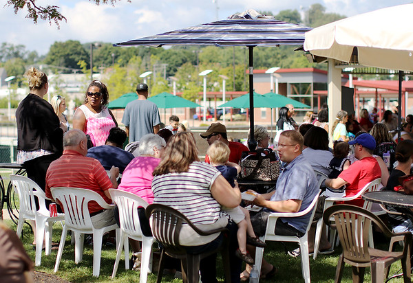 Chris Jackson/The Register-Herald<br /> People gather for the Kids Fest Pretty Baby Contest at Jim Word Park Friday in Beckley.